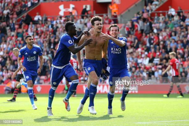 Harry Maguire of Leicester City celebrates with Ben Chilwell and Daniel Amartey of Leicester City after scoring to make it 12 during the Premier...