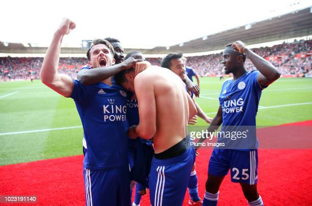 Harry Maguire of Leicester City celebrates with is team mates after scoring to make it 12 during the Premier League match between Southampton and...