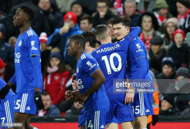 Harry Maguire of Leicester City celebrates with team mates after scoring his goal during the Premier League match between Liverpool FC and Leicester...