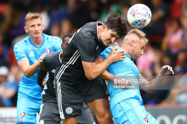 Harry Maguire of Leicester City challenges Luke Varney of Cheltenham Town during the PreSeason Friendly match between Cheltenham Town and Leicester...