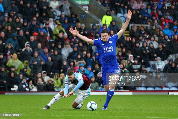 Harry Maguire of Leicester City fouls Johann Gudmundsson of Burnley and is later sent off during the Premier League match between Burnley FC and...