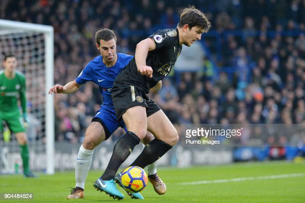 Harry Maguire of Leicester City in action with Cesar Azpilicueta of Chelsea during the Premier League match between Chelsea and Leicester City at...