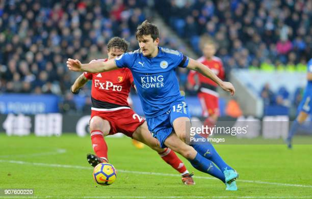 Harry Maguire of Leicester City in action with Daryl Janmaat of Watford during the Premier League match between Leicester City and Watford at The...