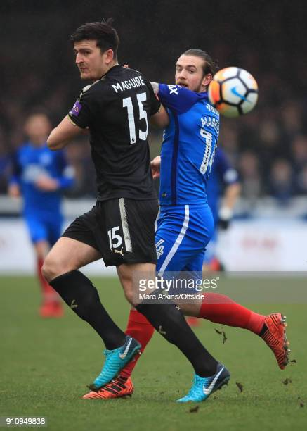 Harry Maguire of Leicester City in action with Jack Marriott of Peterborough United during the FA Cup 4th Round match between Peterborough United and...