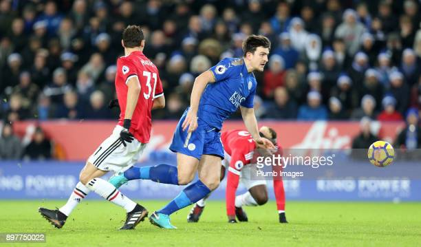 Harry Maguire of Leicester City in action with Namanja Matic of Manchester United during the Premier League match between Leicester City and...