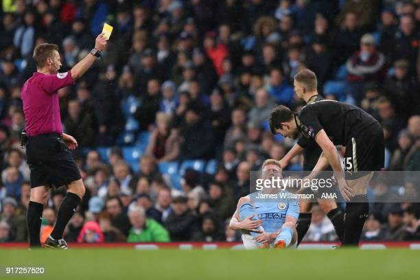Harry Maguire of Leicester City is booked by match referee Michael Jones for a foul on Kevin De Bruyne of Manchester City during the Premier League...