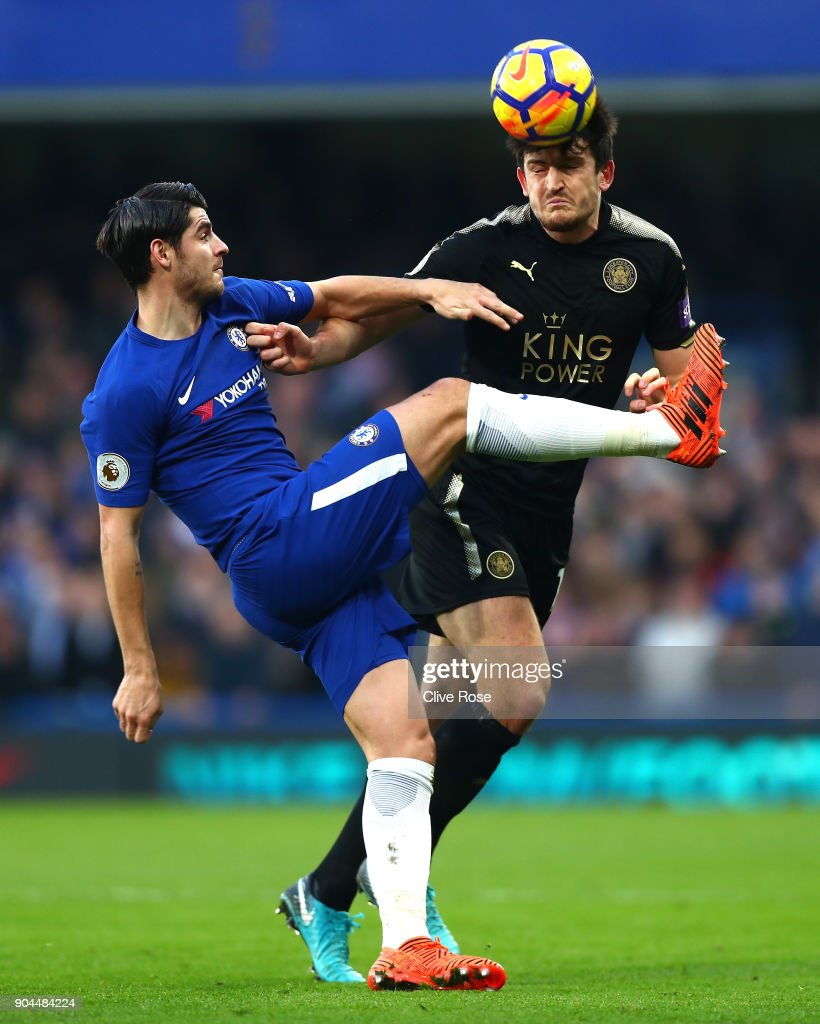 Harry Maguire of Leicester City is challenged by Alvaro Morata of Chelsea during the Premier League match between Chelsea and Leicester City at Stamford Bridge on January 13, 2018 in London, England.