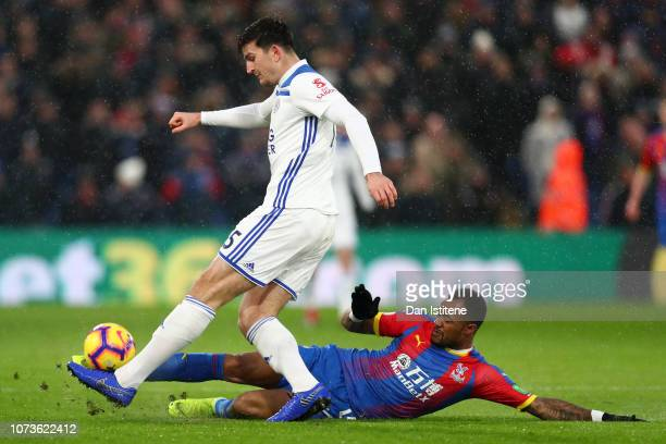 Harry Maguire of Leicester City is challenged by Jordan Ayew of Crystal Palace during the Premier League match between Crystal Palace and Leicester...