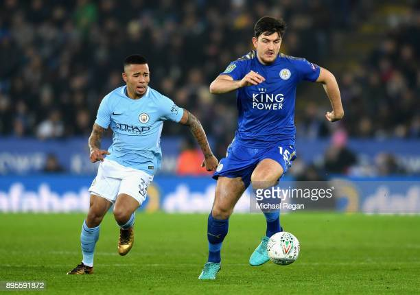 Harry Maguire of Leicester City is chased by Gabriel Jesus of Manchester City during the Carabao Cup QuarterFinal match between Leicester City and...