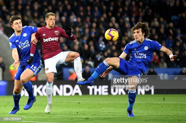 Harry Maguire of Leicester City Javier Hernandez of West Ham United and Caglar Soyuncu of Leicester City compete for the ball during the Premier...