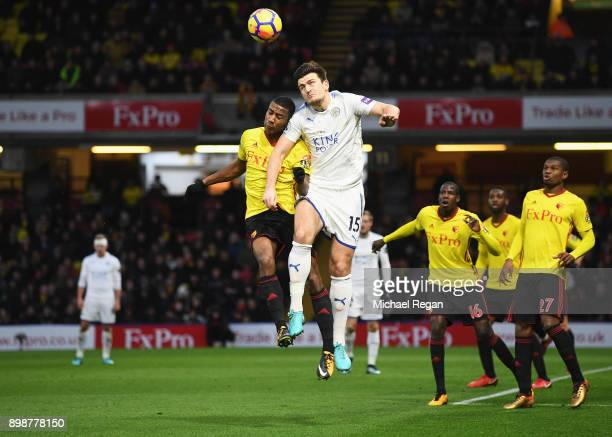Harry Maguire of Leicester City jumps for a header with Marvin Zeegelaar of Watford during the Premier League match between Watford and Leicester...
