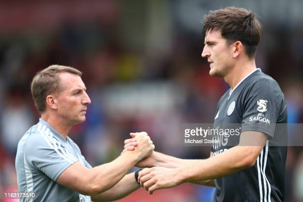 Harry Maguire of Leicester City shakes hands with manager Brendan Rodgers during the PreSeason Friendly match between Cheltenham Town and Leicester...