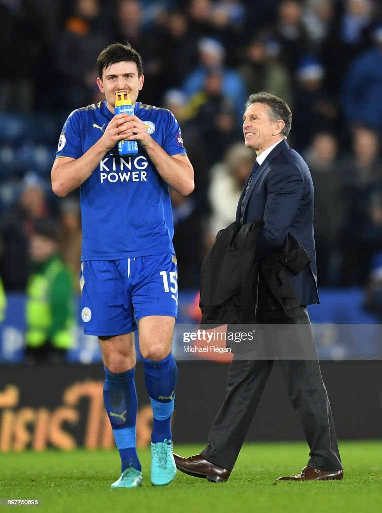 Harry Maguire of Leicester City smiles with Claude Puel, Manager of Leicester City after the Premier League match between Leicester City and Manchester United at The King Power Stadium on December 23, 2017 in Leicester, England.