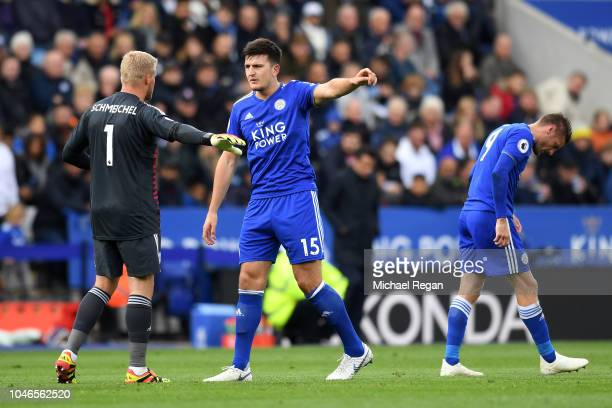 Harry Maguire of Leicester City speaks with Kasper Schmeichel of Leicester City during the Premier League match between Leicester City and Everton FC...