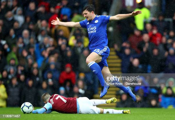 Harry Maguire of Leicester City tackles Johann Berg Gudmundsson of Burnley FC for which he was given a red card during the Premier League match...