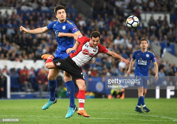 Harry Maguire of Leicester City wins a header over Cedric Soares of Southampton during the Premier League match between Leicester City and...