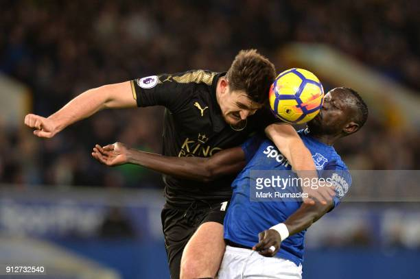 Harry Maguire of Leicester City wins a header over Oumar Niasse of Everton during the Premier League match between Everton and Leicester City at...