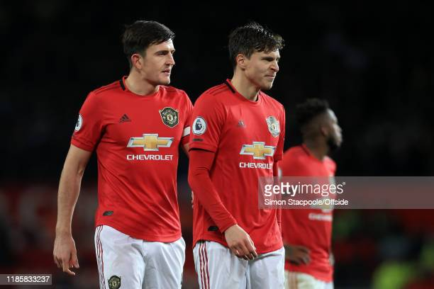 Harry Maguire of Man Utd and Victor Lindelof of Man Utd look dejected during the Premier League match between Manchester United and Aston Villa at...