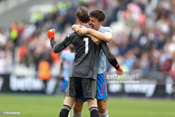 Harry Maguire of Man Utd congratulates goalkeeper David de Gea for his last minute penalty save as they celebrate their 2-1 victory during the...