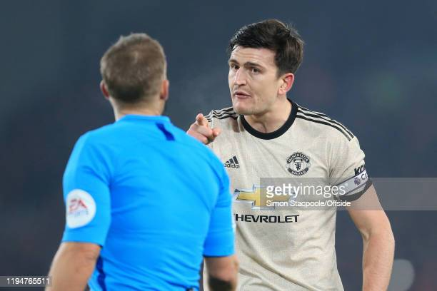 Harry Maguire of Man Utd points an accusing finger at referee Craig Pawson during the Premier League match between Liverpool FC and Manchester United...