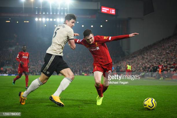 Harry Maguire of Manchester United and Andrew Robertson of Liverpool in action during the Premier League match between Liverpool FC and Manchester...
