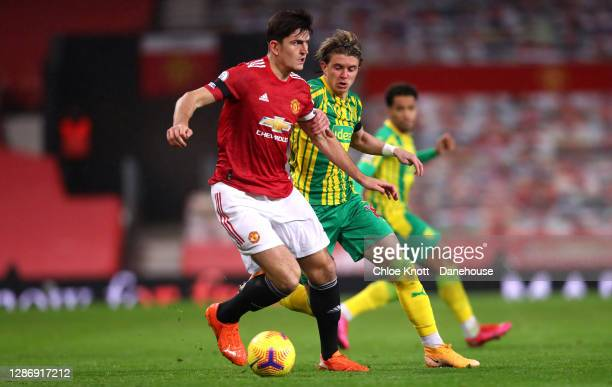 Harry Maguire of Manchester United and Kyle Bartley of West Bromwich Albion in action during the Premier League match between Manchester United and...
