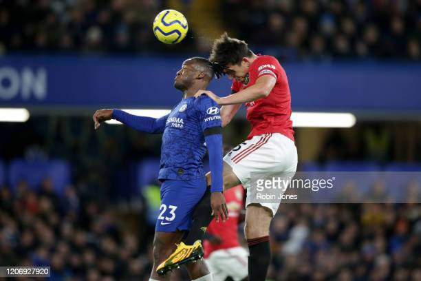 Harry Maguire of Manchester United and Michy Batshuayi of Chelsea during the Premier League match between Chelsea FC and Manchester United at...
