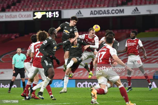 Harry Maguire of Manchester United and Rob Holding of Arsenal jump to win a header during the Premier League match between Arsenal and Manchester...