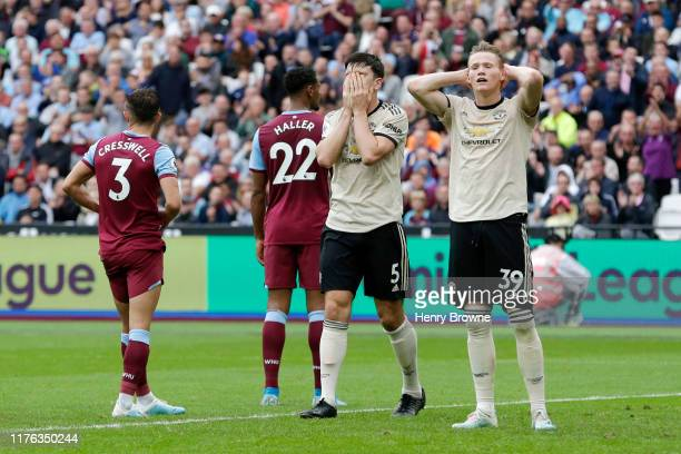 Harry Maguire of Manchester United and Scott McTominay react during the Premier League match between West Ham United and Manchester United at London...