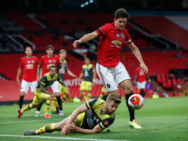 Harry Maguire of Manchester United and Stuart Armstrong of Southampton compete for the ball during the Premier League match between Manchester United...