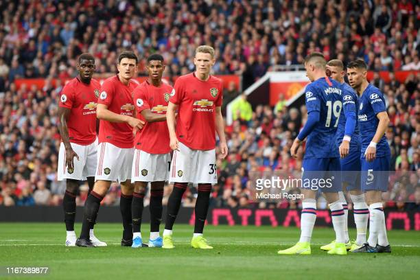 Harry Maguire of Manchester United and teammates prepare to compete for a corner during the Premier League match between Manchester United and...