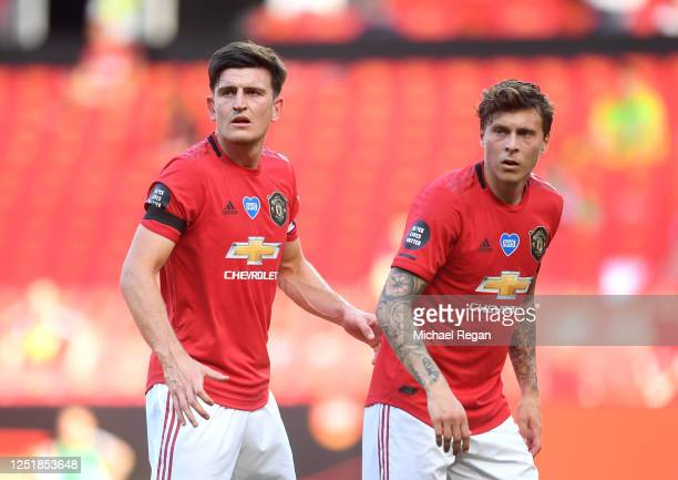 Harry Maguire of Manchester United and Victor Lindelof look on during the Premier League match between Manchester United and Sheffield United at Old...
