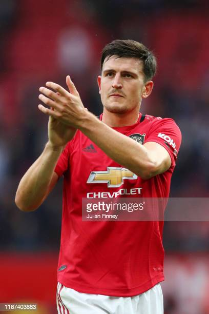 Harry Maguire of Manchester United applauds the crowd following his teams victory in the Premier League match between Manchester United and Chelsea...