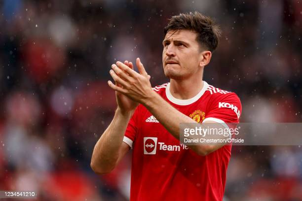 Harry Maguire of Manchester United. Applauds the fans at full time at Old Trafford on August 7, 2021 in Manchester, England.