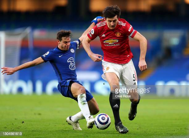 Harry Maguire of Manchester United battles for possession with Cesar Azpilicueta of Chelsea during the Premier League match between Chelsea and...