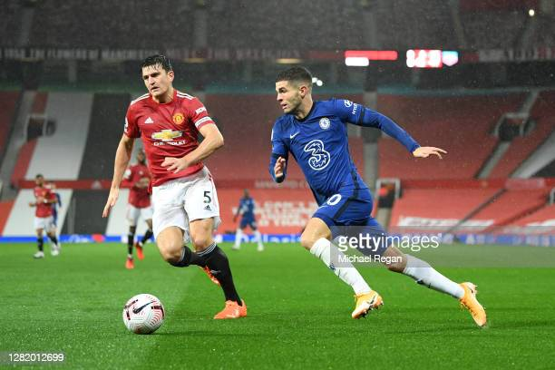 Harry Maguire of Manchester United battles for possession with Christian Pulisic of Chelsea during the Premier League match between Manchester United...