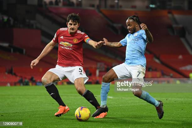 Harry Maguire of Manchester United battles for possession with Raheem Sterling of Manchester City during the Premier League match between Manchester...