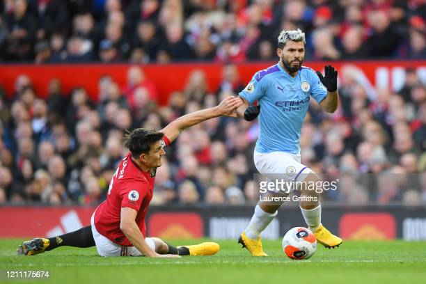 Harry Maguire of Manchester United battles for possession with Sergio Aguero of Manchester City during the Premier League match between Manchester...