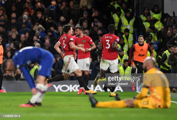 Harry Maguire of Manchester United celebrates after scoring his sides second goal during the Premier League match between Chelsea FC and Manchester...