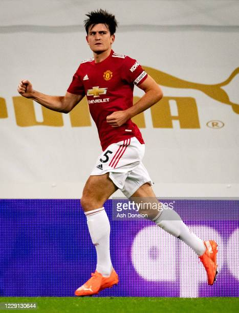 Harry Maguire of Manchester United celebrates scoring a goal to make the score 1-1 during the Premier League match between Newcastle United and...