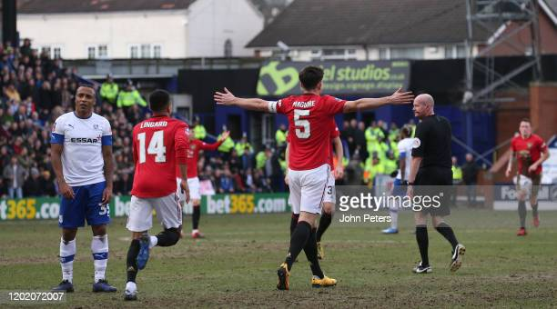 Harry Maguire of Manchester United celebrates scoring their first goal during the FA Cup Fourth Round match between Tranmere Rovers and Manchester...