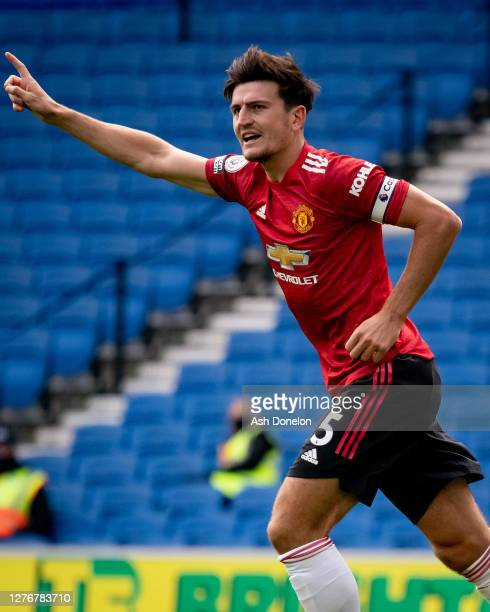Harry Maguire of Manchester United celebrates scoring their first goal during the Premier League match between Brighton & Hove Albion and Manchester...