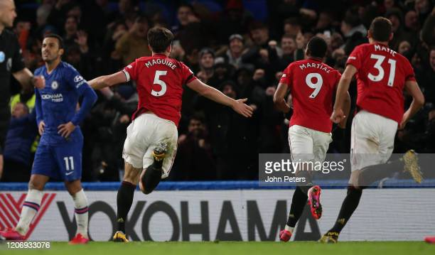 Harry Maguire of Manchester United celebrates scoring their second goal during the Premier League match between Chelsea FC and Manchester United at...
