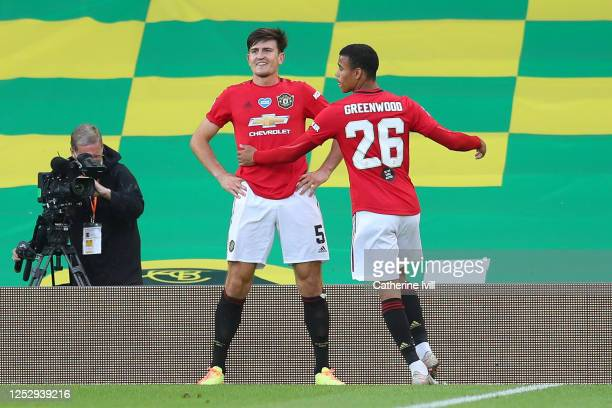 Harry Maguire of Manchester United celebrates with Mason Greenwood of Manchester United after scoring his teams second goal during the FA Cup Quarter...