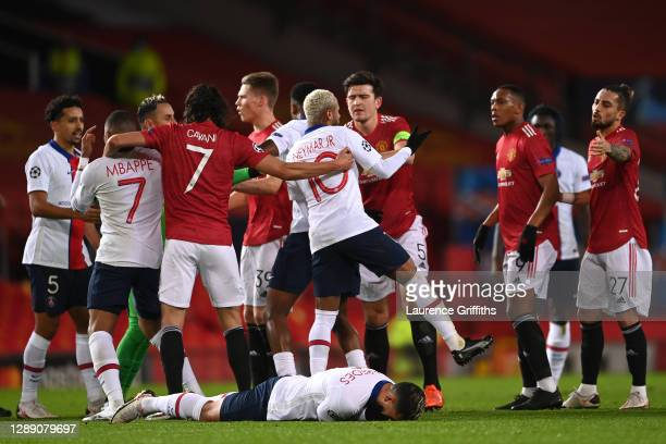 Harry Maguire of Manchester United clashes with Neymar of Paris Saint-Germain after Leandro Paredes of Paris Saint-Germain is fouled during the UEFA...