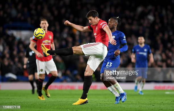 Harry Maguire of Manchester United clears under pressure from the Michy Batshuayi of Chelsea during the Premier League match between Chelsea FC and...