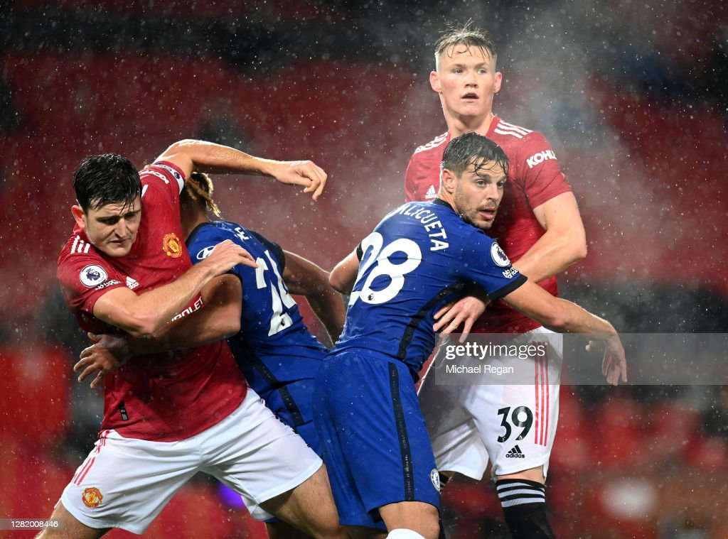 Harry Maguire of Manchester United collides with Reece James of... News  Photo - Getty Images