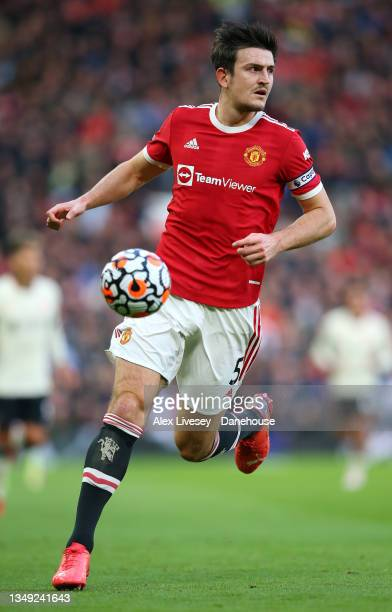 Harry Maguire of Manchester United controls the ball during the Premier League match between Manchester United and Liverpool at Old Trafford on...