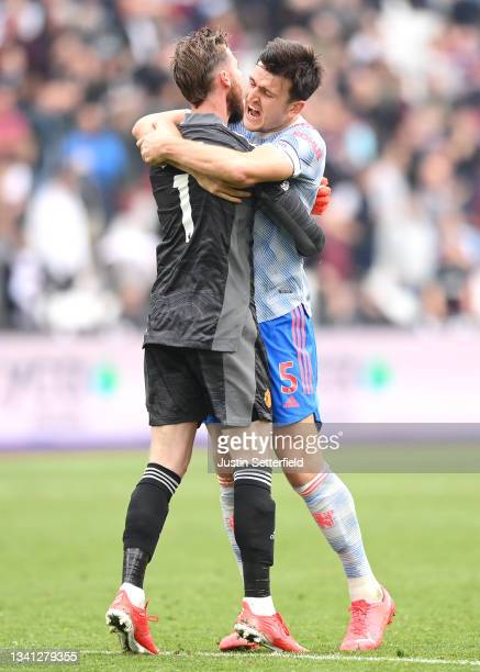 Harry Maguire of Manchester United embraces teammate David De Gea after saving the penalty taken by Mark Noble of West Ham United during the Premier...