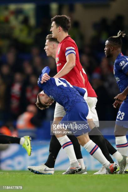 Harry Maguire of Manchester United gets to grips with Billy Gilmour of Chelsea during the Carabao Cup Round of 16 match between Chelsea FC and...